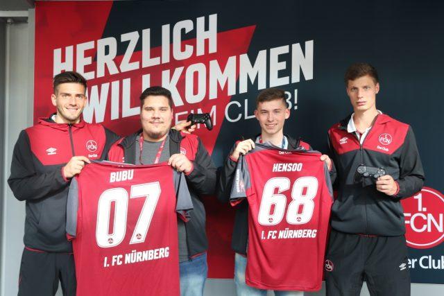 Von links nach rechts: FCN-Torhüter Fabian Bredlow, Daniel Butenko (