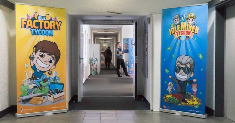 """Der Eingangsbereich wird flankiert von den Grafiken der beiden Fluffy-Fairy-Apps: """"Idle Factory Tycoon"""" und """"Idle Miner Tycoon""""."""